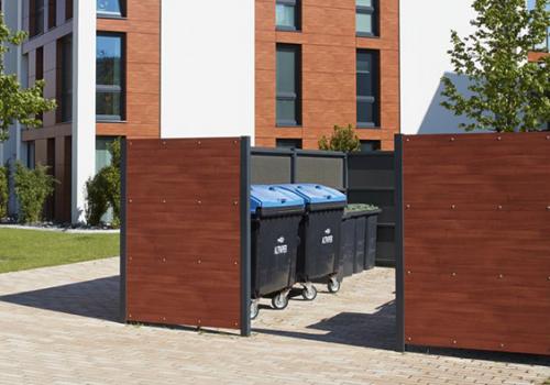 Mlüll-Container Einhausung oder Umhausung.